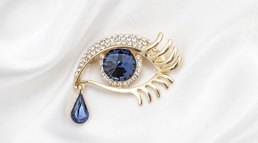 Brosch med safirer och diamanter
